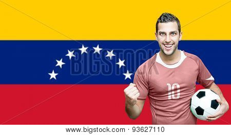 Venezuelan fan celebrates on Venezuela flag background