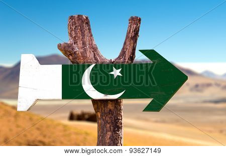 Pakistan Flag wooden sign with desert road background