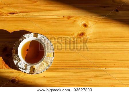 antique porcelain tea cup on wooden background