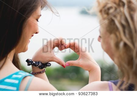 Two Girls Making Heart Shape
