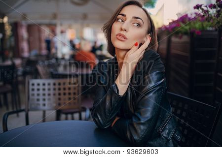 pretty girl sitting in a cafe
