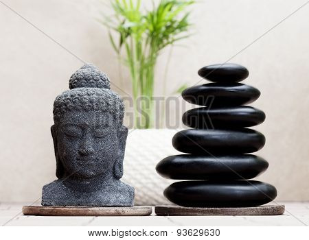 zen buddha statue and black pebble stones