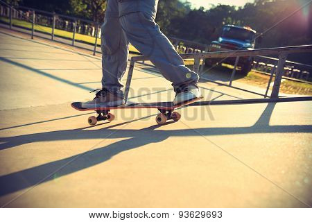 closeup of young woman skateboarding at skatepark,vintage effect