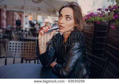 beautiful glamorous brunette smoke electronic cigarette