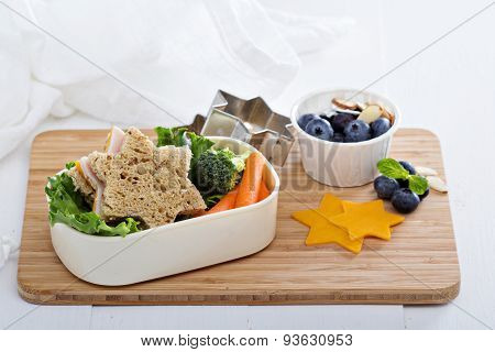 Lunch box with sandwich and salad