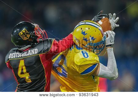 ST. POELTEN, AUSTRIA - JUNE 3, 2014: WR Fredrik Lsaksson (#6 Sweden) is tackled by DB Paul Motzki (#4 Germany) during the Football EC European Championchip in St Poelten, Austria.
