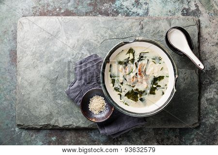 Creamy Soup With Eel And Sesame On Stone Slate Background