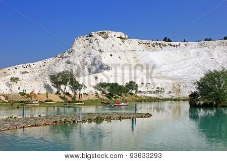 Lake And Calcified Limestone Terraces On Background, Pamukkale, Turkey