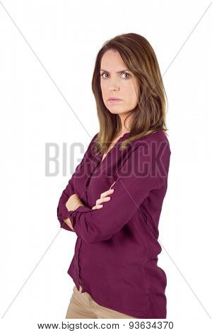 Unhappy woman looking at camera with arm crossed on white background