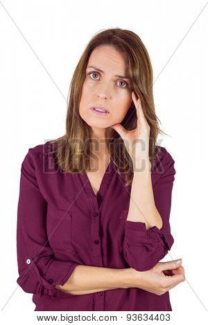 Pretty brunette with headache on white background