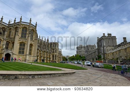 WINDSOR, ENGLAND - JUNE 11, 2015: Exterior facade of St Georges Chapel, in the Lower Ward of Windsor Castle, England, the official residence of the Queen, a popular tourist landmark on June 11, 2015