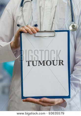 Doctor Holds Clipboard With Tumour Diagnosis