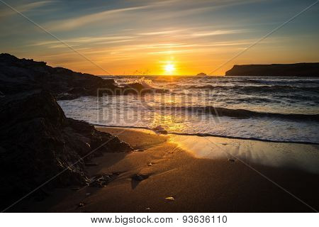 Sunset at Polzeath beach, Cornwall - a popular spot for surfers in the UK