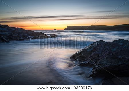 After the sun has set at Polzeath beach, Cornwall, UK - slow shutter speed to give blurred motion in the water