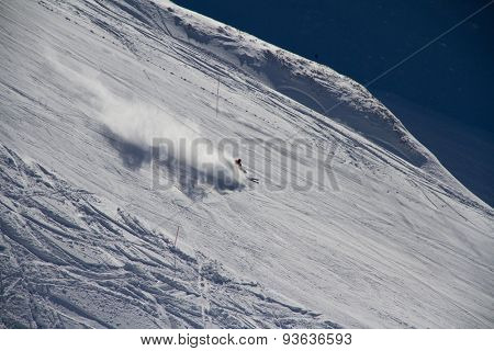 Skier going down the slope at ski resort. Krasnaya Polyana, Sochi, Russia