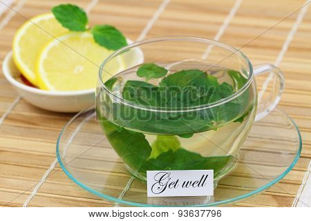 Get well card with cup of mint tea and lemon