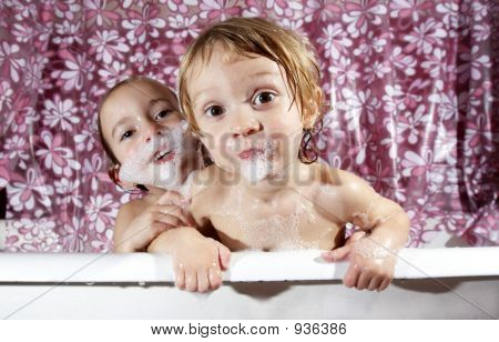 Bath Time Is Fun! - Two Younge Children Playing In The Bath