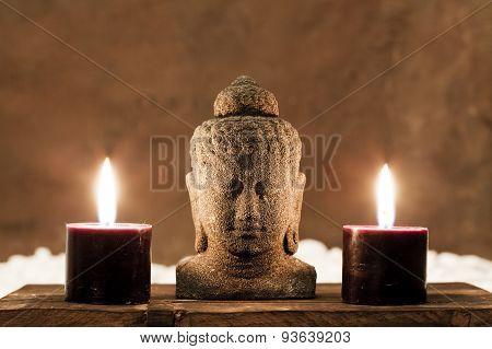buddha statue and candles zen meditation