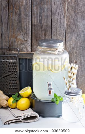 Ginger homemade lemonade in a beverage dispenser