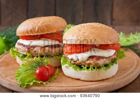 Appetizing hamburger with chicken burger and sauce Tartar
