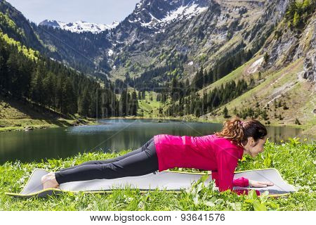 Woman Doing Forearm Plank Pose Outdoors