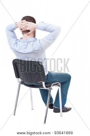 back view of business man sitting on chair.  businessman watching. Rear view people collection. Isolated over white background. guy in blue shirt sitting in chair with his hands behind his head.