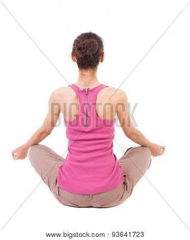 Back view girl sitting in front of warm up exercise. Rear view people collection.  backside view person. Isolated over white background. African-American woman sitting in lotus position and meditates