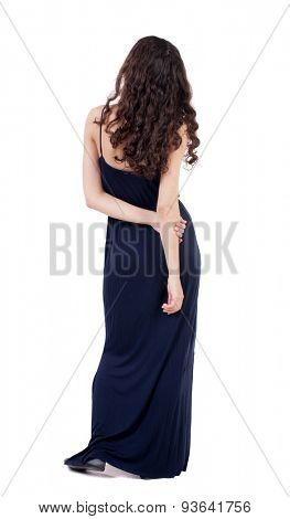 back view standing young beautiful  woman.  girl  watching. Rear view people collection. backside view of person.  Isolated over white background. Girl in blue evening dress is hand clasping his hand