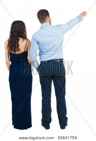 young couple pointing at wal Back view  (woman and man). Rear view people collection.  backside view of person.  Isolated over white background. Couple in evening dress view something