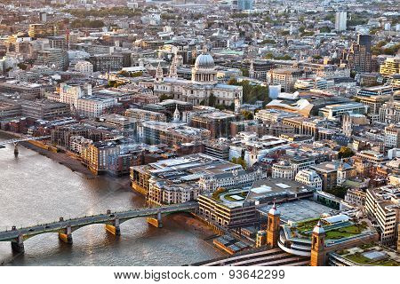 Aerial view over City of London St Pauls cathedral Thames river at sunset