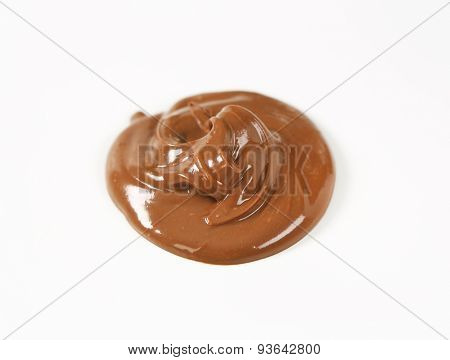 blob of chocolate spread on white background