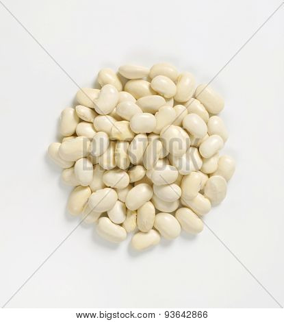 heap of raw white beans on white background