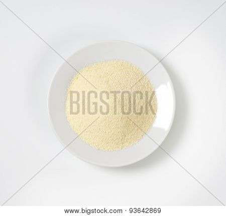 plate of grits on white background