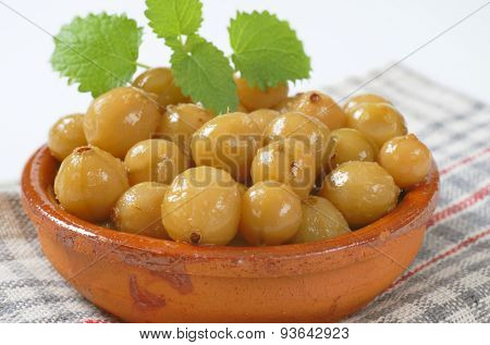 bowl of stewed gooseberries on checkered dishtowel - detail