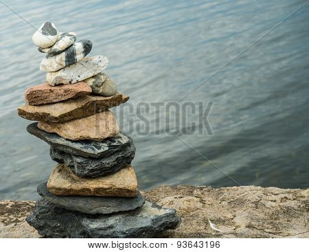 Cairn on rocky lake shore