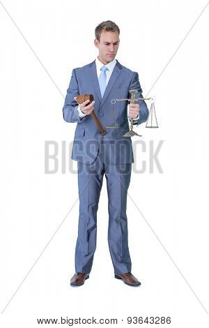 Businessman holding hammer and balance on white background