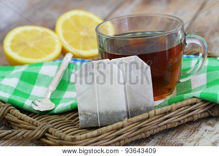 Tea and tea bags on wicker tray