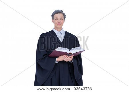 Lawyer looking at camera and holding law code on white background