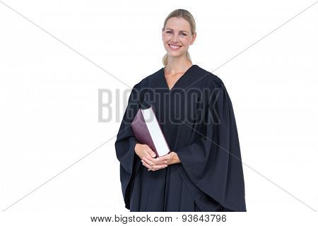 Happy pretty lawyer holding law code on white background
