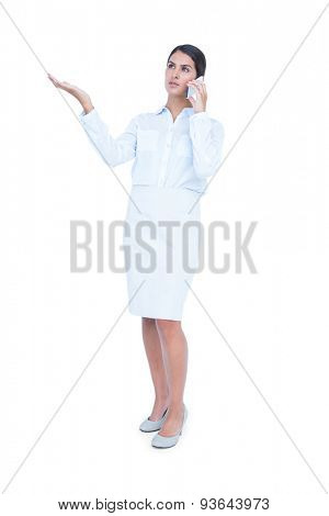 Businesswoman having phone call on white background