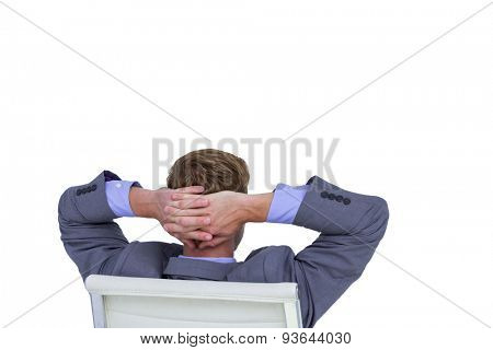 Relaxed businessman extended on a chair on a white background