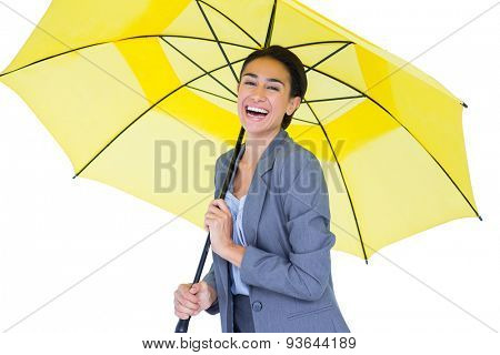 Smiling businesswoman sheltering under umbrella on white background