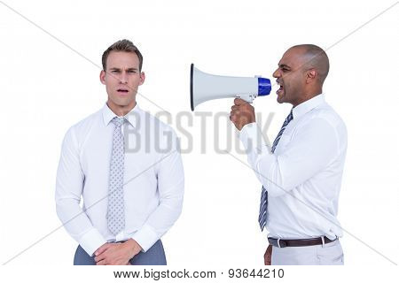 Businessman yelling with a megaphone at his colleague on white background