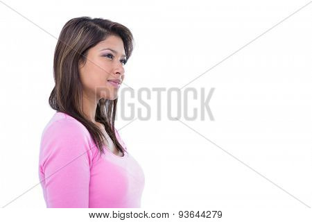 Side view of thoughtful pretty brunette looking away on white background