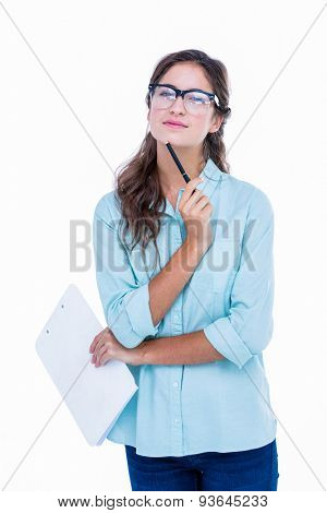 Thoughtful geeky hipster with a pen against her chin on white background