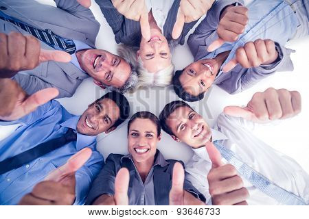 Business people gesturing thumbs up on white background