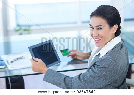 Businesswoman doing online shopping in office at work