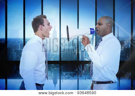 Businessman yelling with a megaphone at his colleague against room with large window looking on city