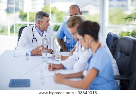 Teams of doctors working together in medical office