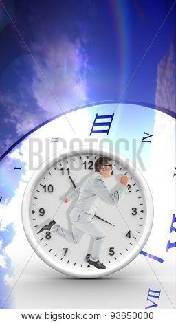 Geeky happy businessman running mid air against digitally generated roman numeral clock